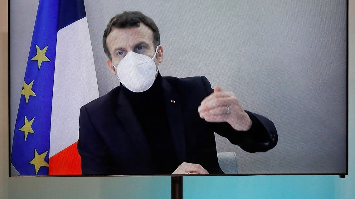 French President Macron, tested positive for coronavirus, talks by video conference in Paris. (Reuters)
