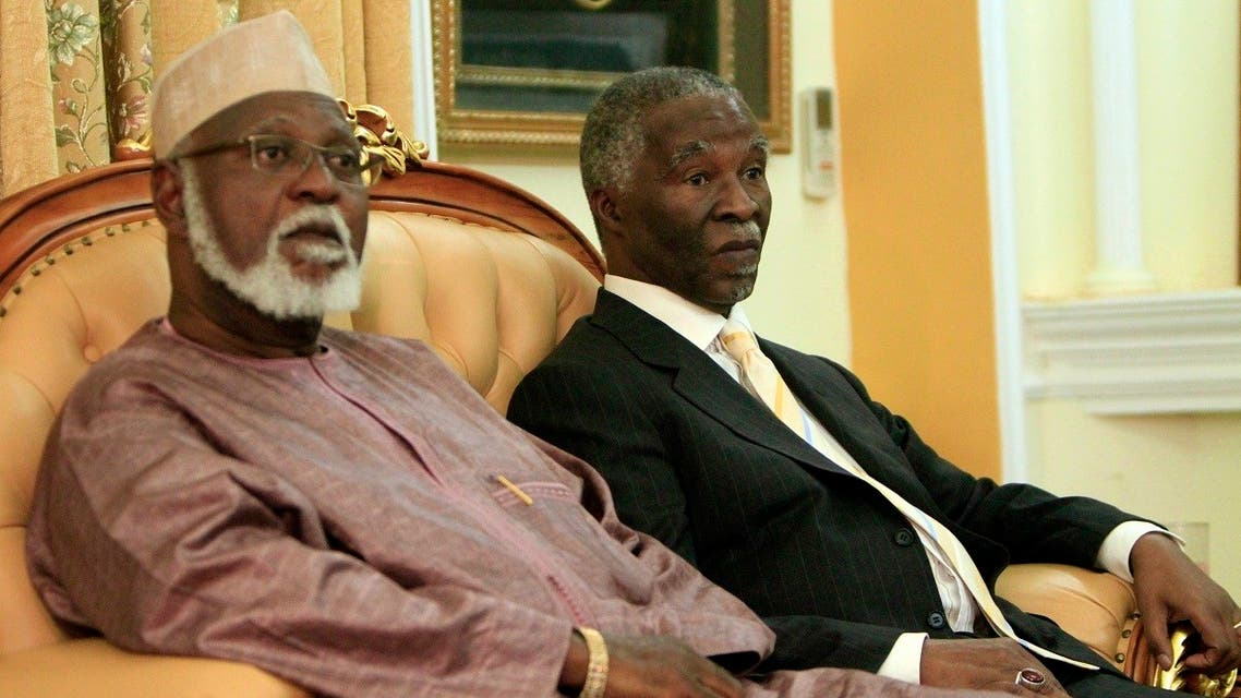 Former South African president Thabo Mbeki and former president of Burundi Pierre Buyoya sit together during a meeting in Khartoum. (File photo: Reuters)