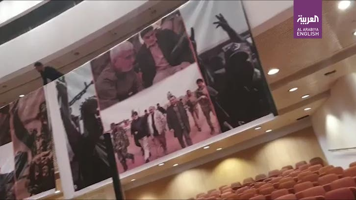 Watch: Posters of Soleimani, al-Mohandes hoisted inside Iraq's parliament