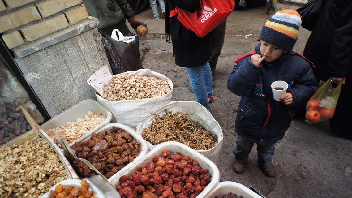 n Iranian boy looks at dried fruit and nuts, consumed during Yalda Night celebrations, at a bazaar in northern Tehran December 21, 2010. (Reuters)