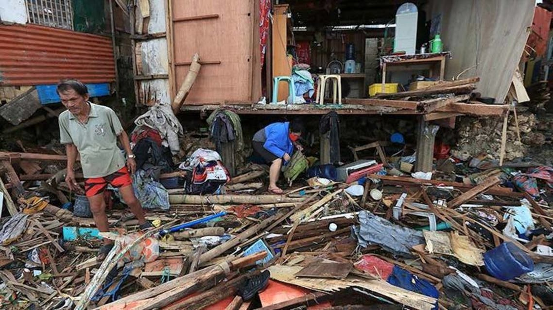 Residents salvage items from their destroyed house after tropical depression Vicky hit Lapu-Lapu City on Saturday. (AFP)