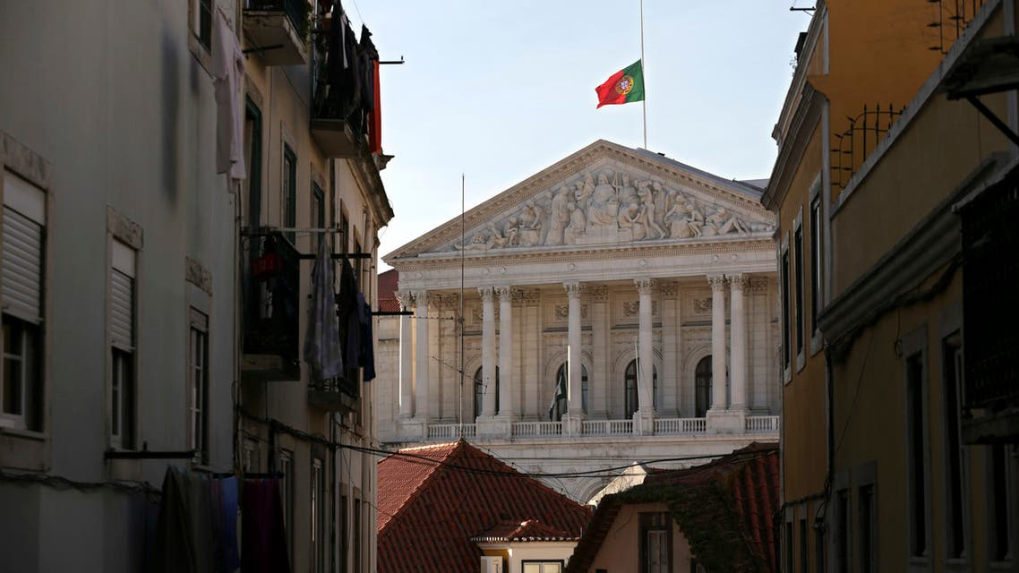 The national flag atop of the Portuguese parliament building in Lisbon (AFP)