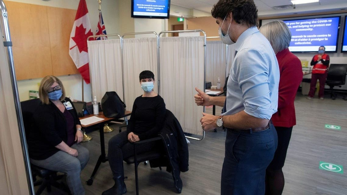 Canadian Prime Minister Justin Trudeau gives the thumbs up to a woman who had received the Pfizer-BioNTech COVID-19 vaccine. (Reuters)