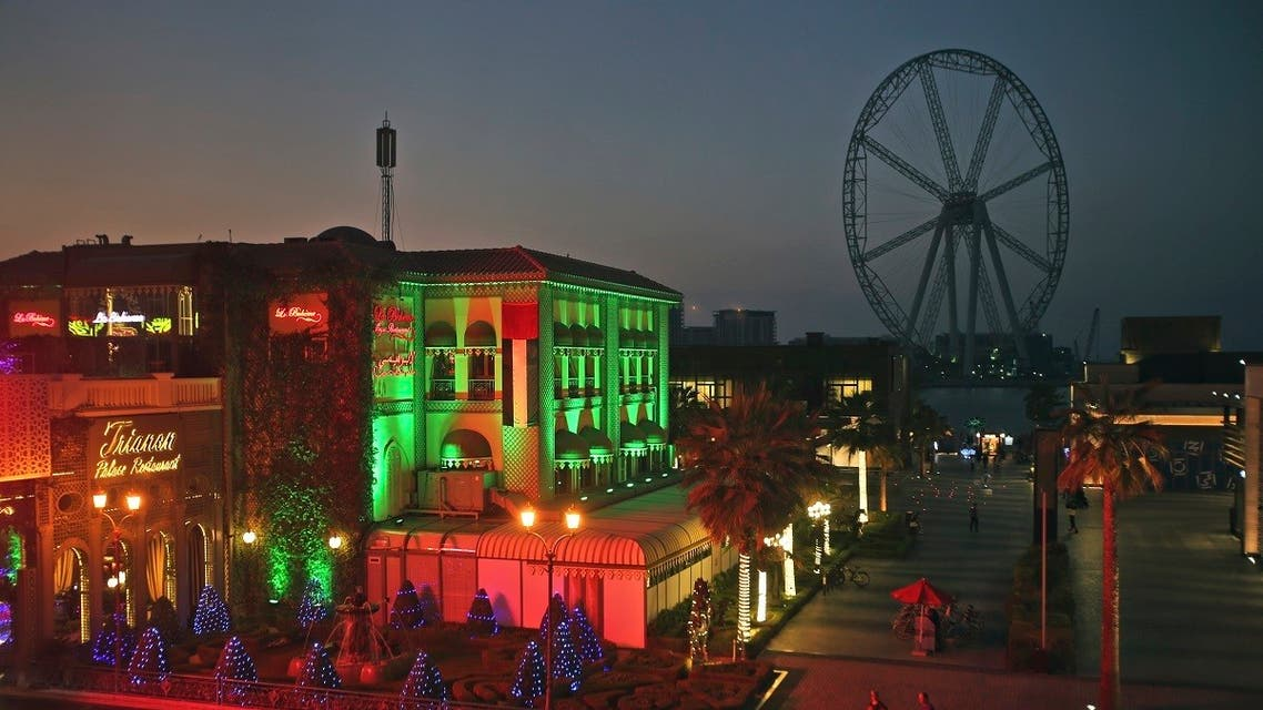 People and cars pass near the Ain Dubai or Dubai Eye, a 853 feet (260 meter) ferris wheel in the Jumeirah Beach Residence district of Dubai, United Arab Emirates. (File photo: AP)