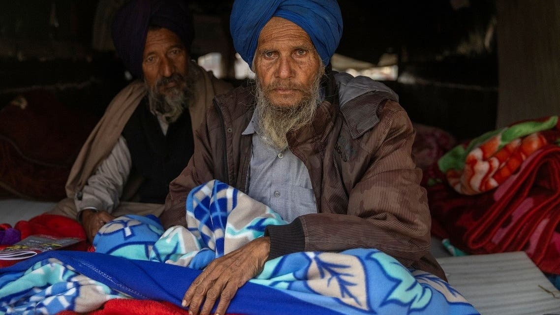 Farmer Paagh Singh, 76, sits inside his tractor trolley on a cold winter morning at the site of a protest against new farm laws, at Singhu border, near New Delhi, India, on December 21, 2020. (Reuters)
