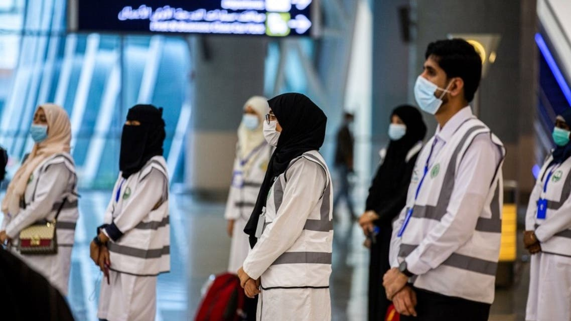 A handout picture provided by the Saudi Ministry of Media on July 25, 2020, shows members of the medical team from Saudi Health ministry at the Red Sea coastal city of Jeddah's King Abdulaziz International Airport. (AFP)