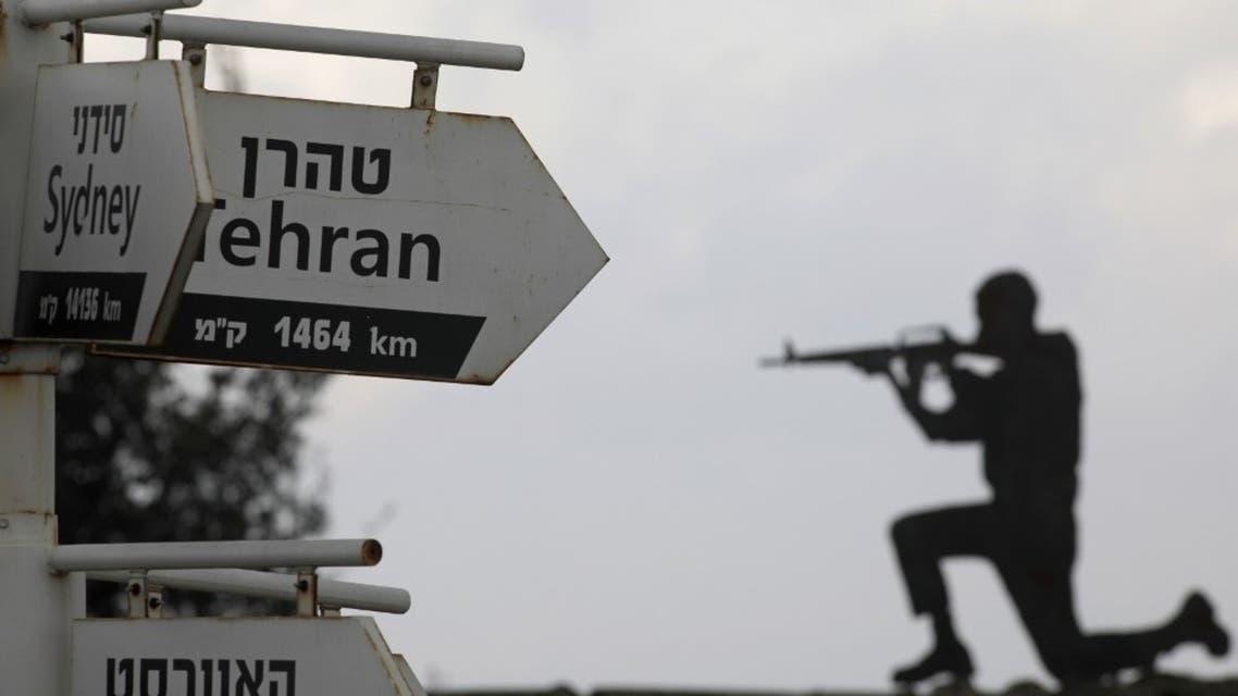 عنصر من الجيش الإسرائيلي بالقرب من هضبة الجولان - أرشيفية من فرانس برس
