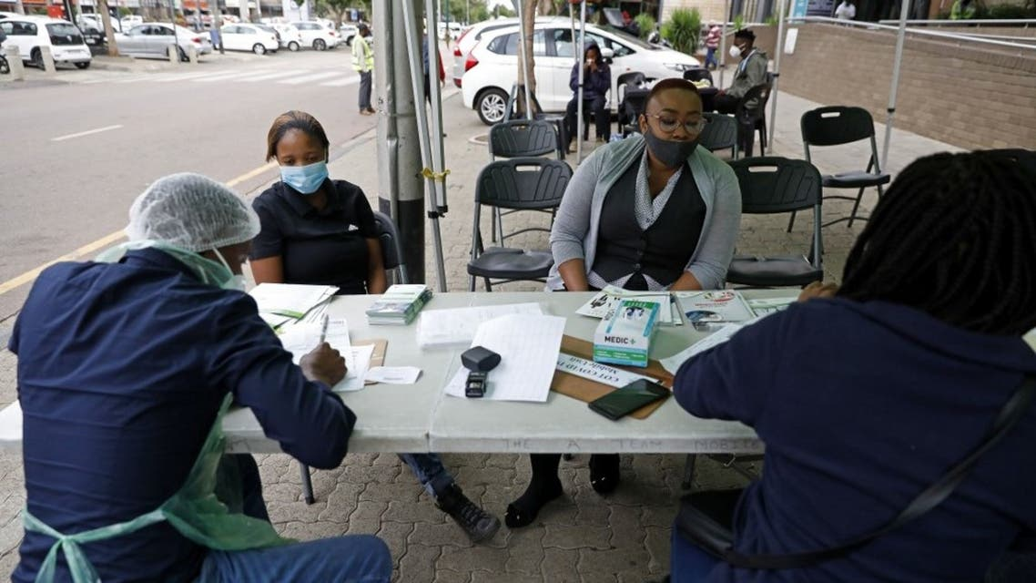 City of Tshwane health professional conduct screening exercises on people before testing for the COVID-19 coronavirus in Pretoria on December 17, 2020. (AFP)