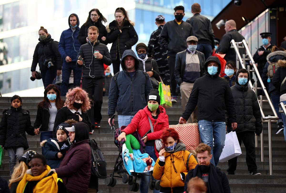 People carrying bags walk down the stairs outside the Westfield Stratford City shopping center, amid the coronavirus outbreak in London, Britain. (Reuters)