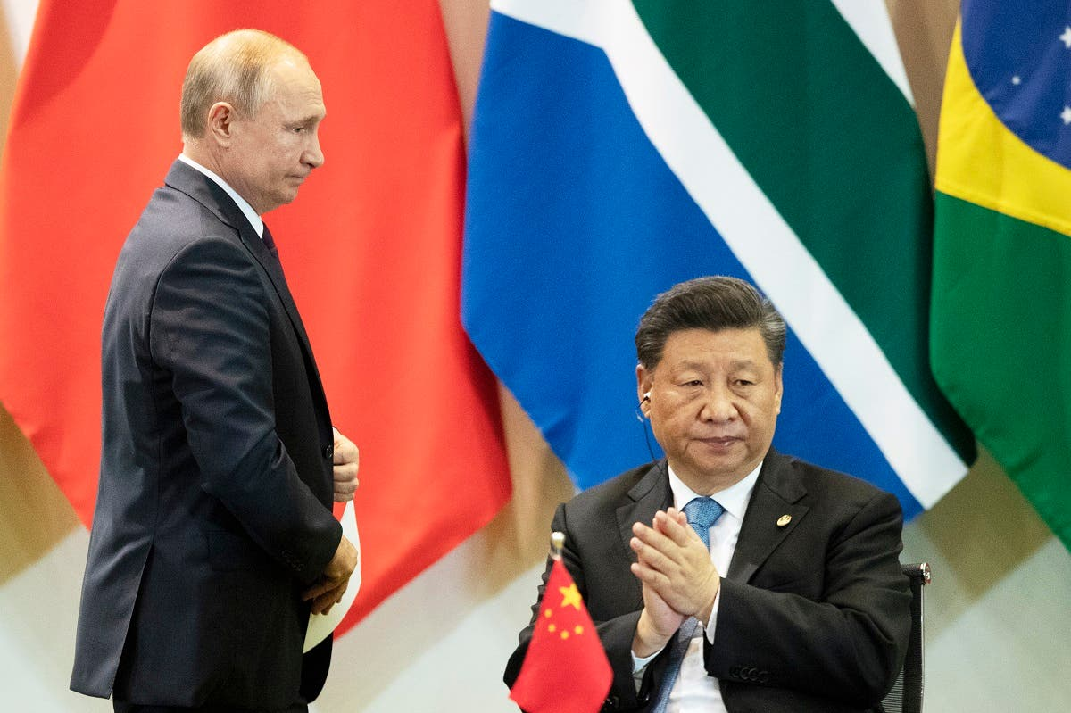China's President Xi Jinping (right), and Russia's President Vladimir Putin attend a meeting with members of the Business Council and management of the New Development Bank during the BRICS emerging economies at the Itamaraty palace in Brasilia, Brazil, on November 14, 2019. (AP)