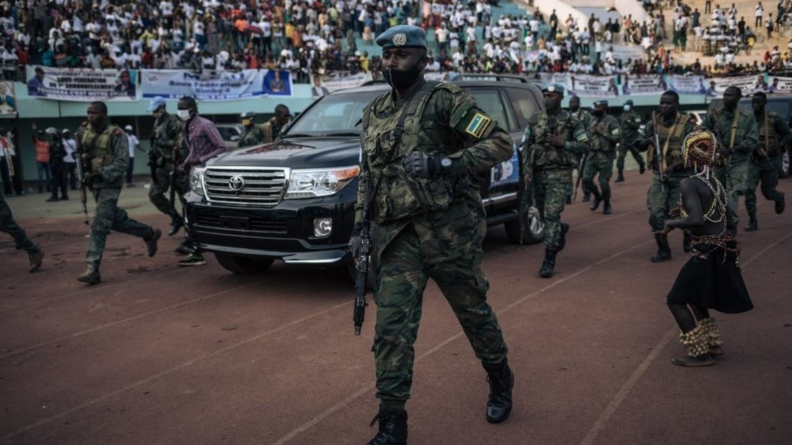 The motorcade of the President of the Central African Republic, arrives at the 20,000-seat stadium, for an electoral rally, escorted by the presidential guard, Russian mercenaries, and Rwandan UN peacekeepers, in Bangui, on December 19, 2020. (Alexis Huguet/AFP)