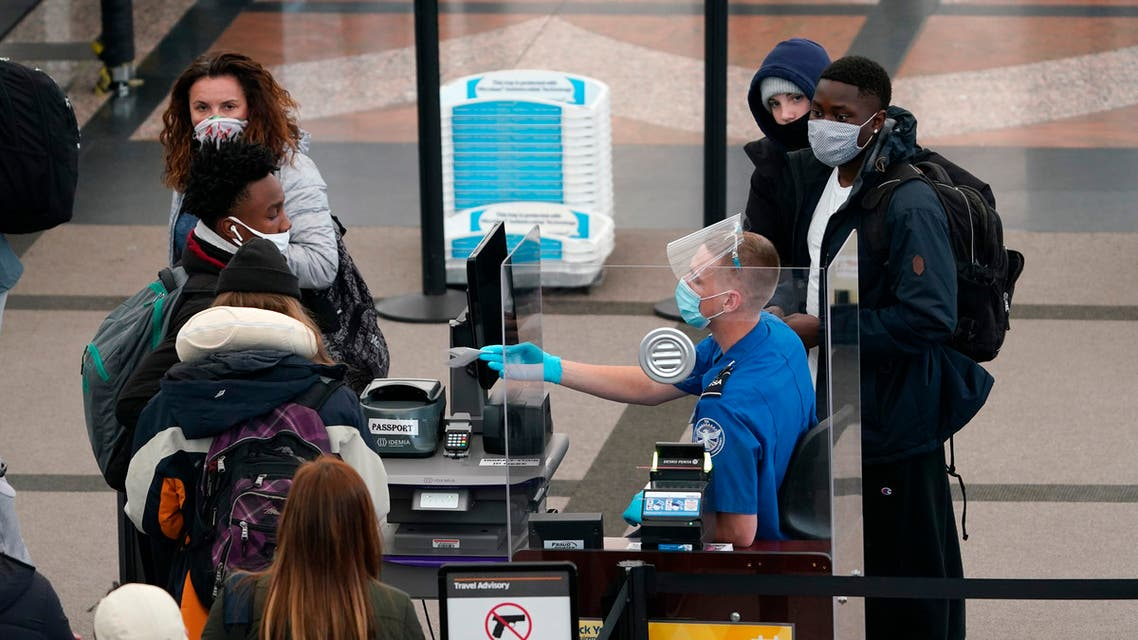 Travellers head through the north security checkpoint in the terminal of Denver International Airport early Thursday, Dec. 10, 2020, in Denver. (AP)