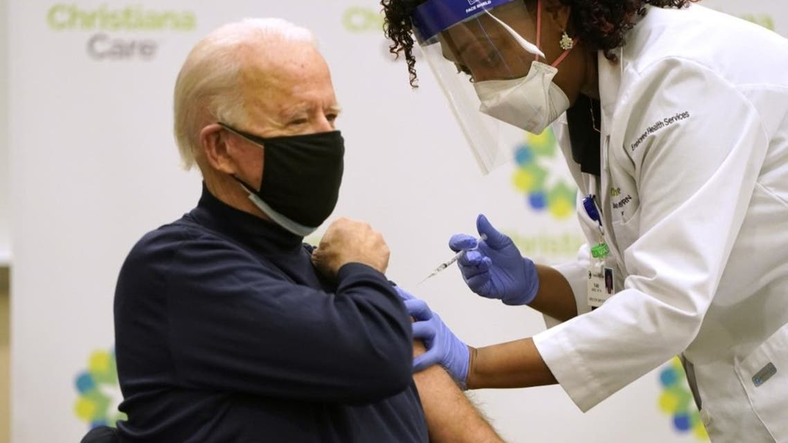 President-elect Joe Biden (L) receives a COVID-19 Vaccination from nurse practitioner Tabe Masa at ChristianaCare Christiana Hospital on December 21, 2020 in Newark, Delaware. (AFP)
