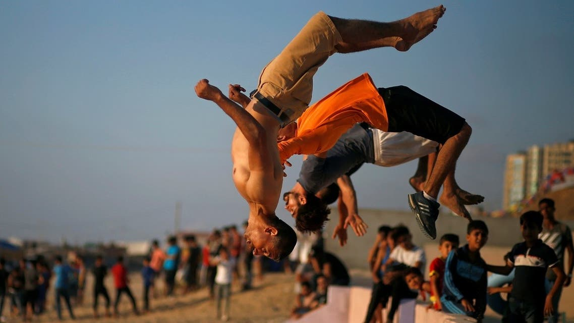 Palestinian men demonstrate their parkour skills on a beach as the coronavirus  restrictions ease in Gaza City. (File photo: Reuters)
