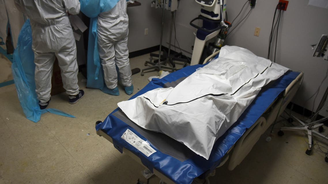 A patient who died lays in a body bag inside a coronavirus disease (COVID-19) unit at United Memorial Medical Center as the United States nears 300,000 COVID-19 deaths, in Houston, Texas, U.S., December 12, 2020. (Reuters)