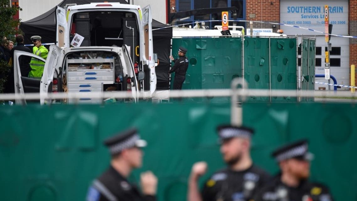 In this file photo taken on October 23, 2019 British Police officers work near a lorry found to be containing 39 dead bodies, inside a police cordon at Waterglade Industrial Park in Grays, east of London, on October 23, 2019. (Ben Stansall/AFP)
