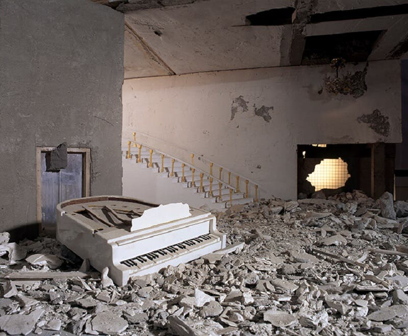 The Ashes Series' are a set of photographs that depict painstakingly reconstructed media images of the destruction caused by the Iraq War. (Courtesy: Wafaa Bilal)