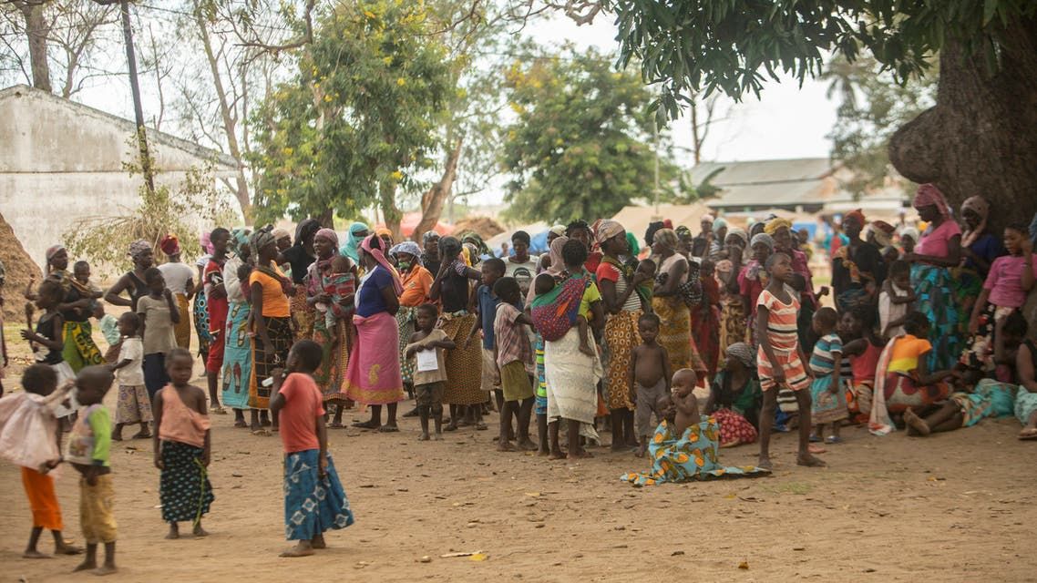 Displaced women meet on December 11, 2020 at the Centro Agr‡rio de Napala where hundreds of displaced arrived in recent months are sheltered, fleeing attacks by armed insurgents in different areas of the province of Cabo Delgado, in northern Mozambique. (AFP)