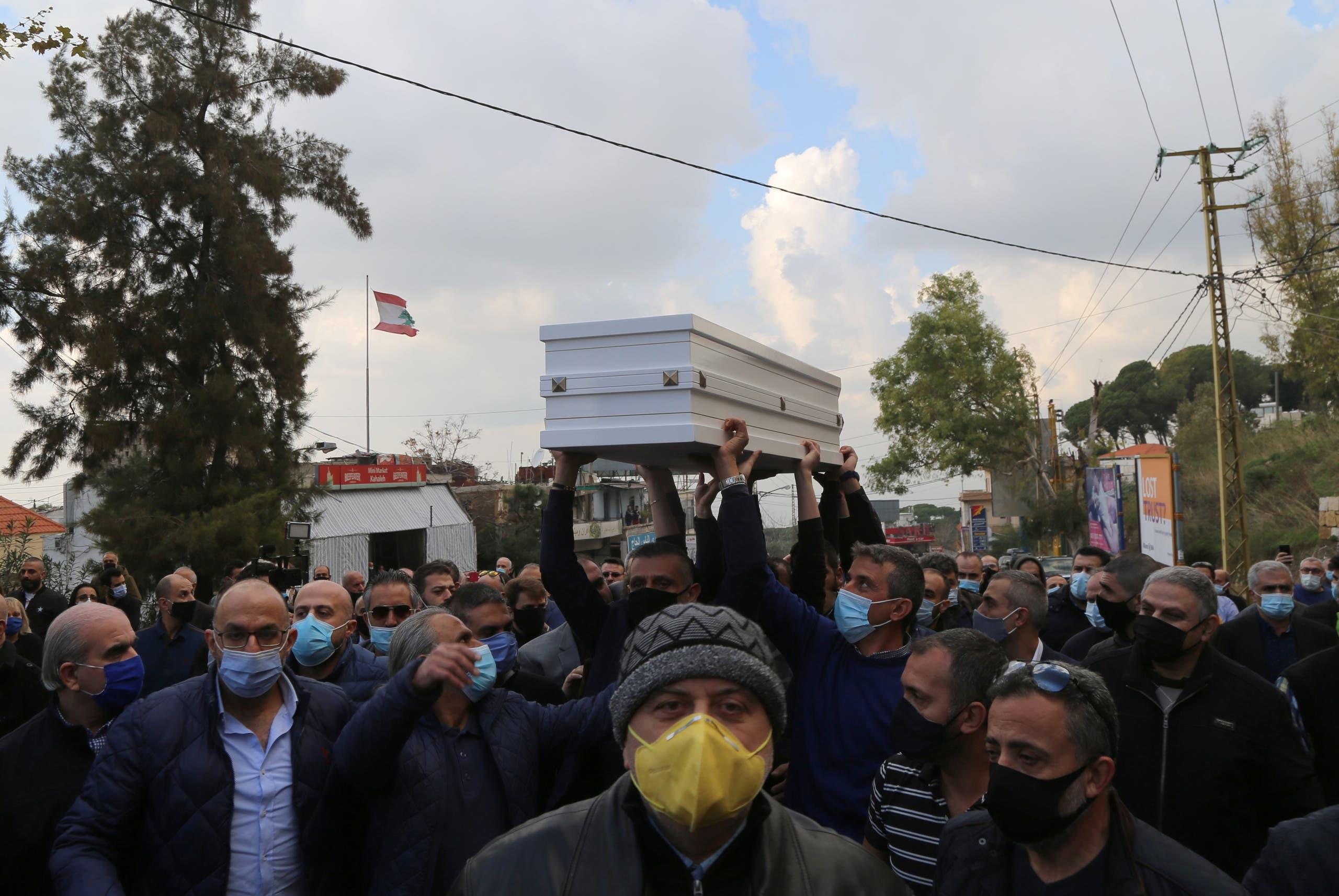 Men carry the coffin of Joe Bejjany, a 36-year-old telecoms employee and freelance photographer, during his funeral in the village of Kahaleh, Lebanon December 22, 2020. (Reuters)