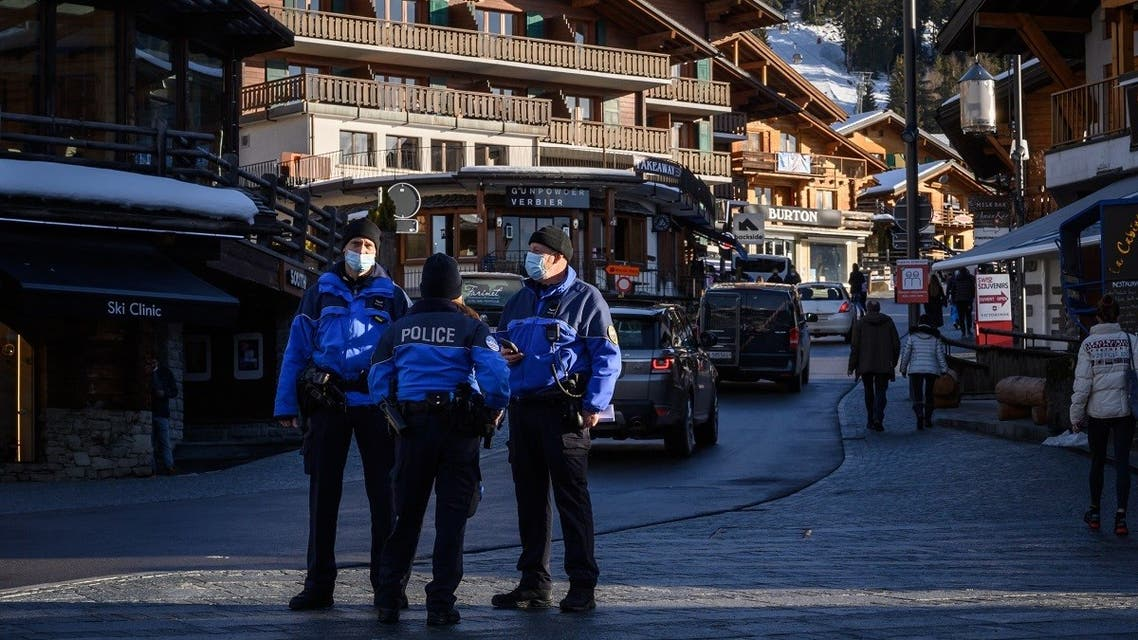 Police officers stand in the street in the Alpine resort of Verbier well known by British ski holiday makers, on December 22, 2020. (AFP)