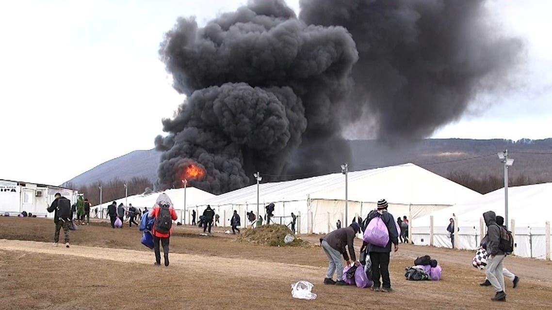 "Migrant camp ""Lipa"" is seen under fire in Bihac, Bosnia and Herzegovina December 23, 2020. (Reuters)"