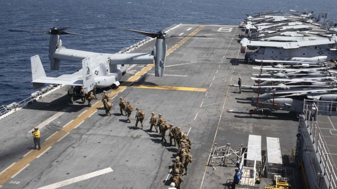 Handout file photo courtesy of US Navy, Marines load into a V-22 Osprey on the flight deck of the USS Makin Island (LHD8) as they conduct maritime operations off the coast of Somalia in support of Operation Octave Quartz (OOQ) on December 22, 2020. (AFP)