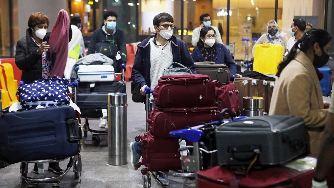 Passengers wearing protective face masks wait to exit upon arrival in Mumbai, India after India cancelled all flights from the UK over fears of a new strain of the coronavirus. (File Photo: Reuters)