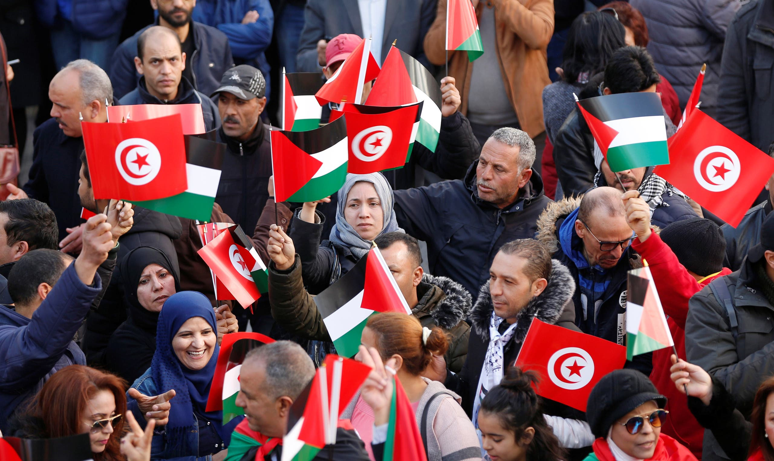 Protesters holding Palestinian and Tunisian flags shout slogans during a protest against U.S. President Donald Trump's Middle East peace plan, in the down town of Tunis, Tunisia February 5, 2020. (Reuters)