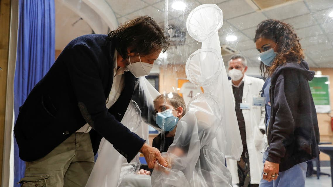 Hospitalized children can hug their relatives through a plastic protection, in Rome. (Reuters)