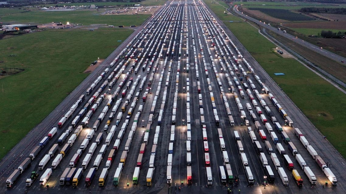 An aerial view shows lines of freight lorries and heavy goods vehicles parked on the tarmac at Manston Airport near Ramsgate, south east England. (AFP)