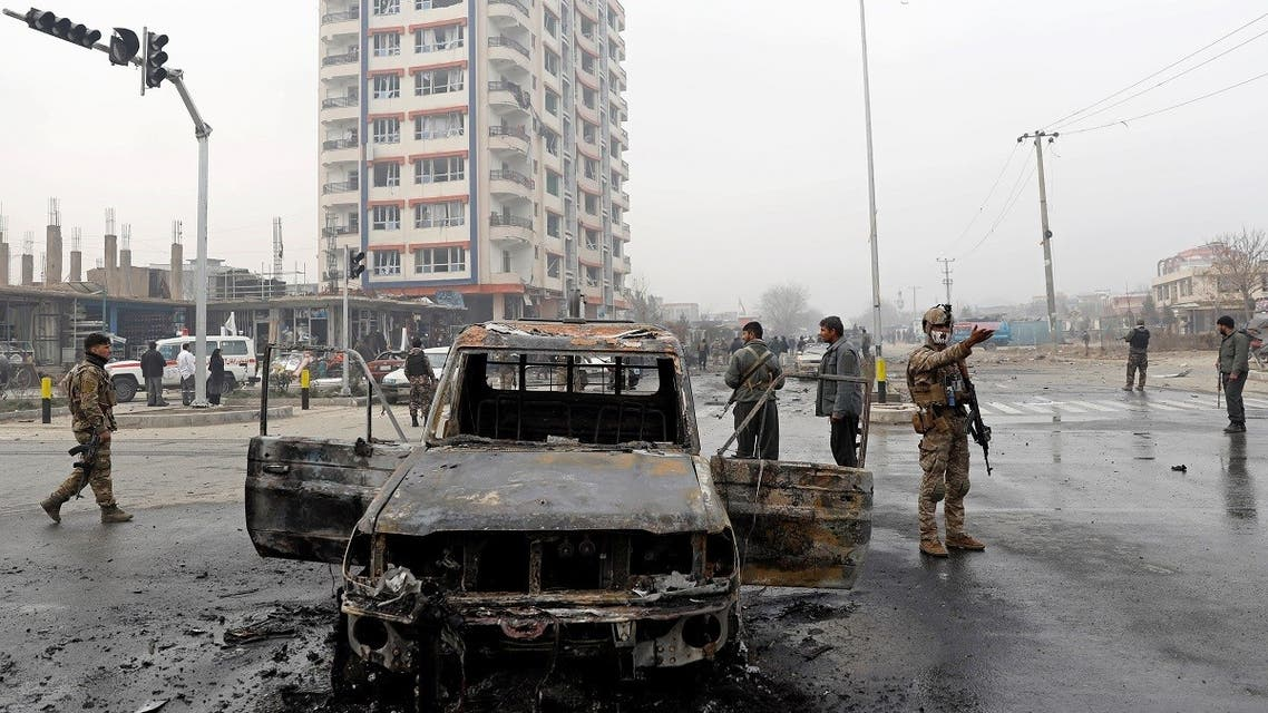 Afghan security forces inspect at the site of a blast in Kabul, Afghanistan, on December 20, 2020. (Reuters)