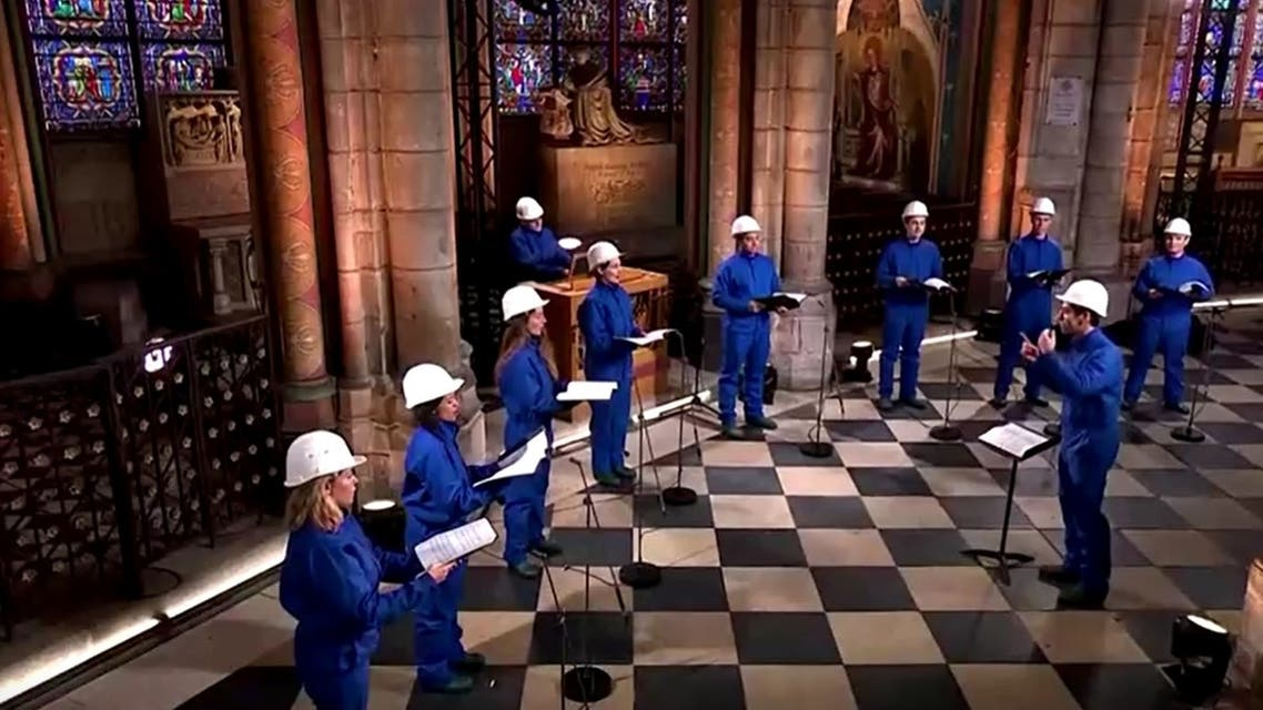 With choir in hard hats, fire-ravaged Notre-Dame rings in Christmas. (Screengrab)