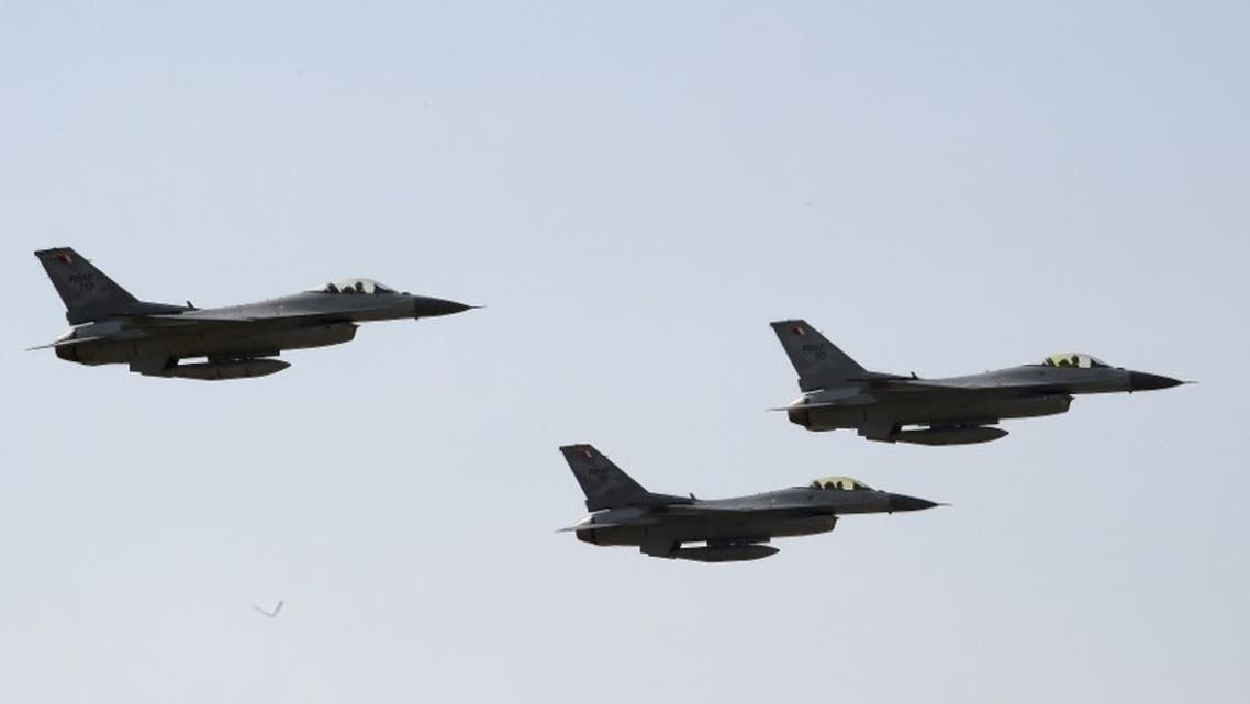 Royal Bahraini Air Force F-16s perform air maneuvers during the 2018 Bahrain International Airshow (BIAS) at the Sakhir Airbase, south of the Bahraini capital Manama on November 14 2018. (AFP)