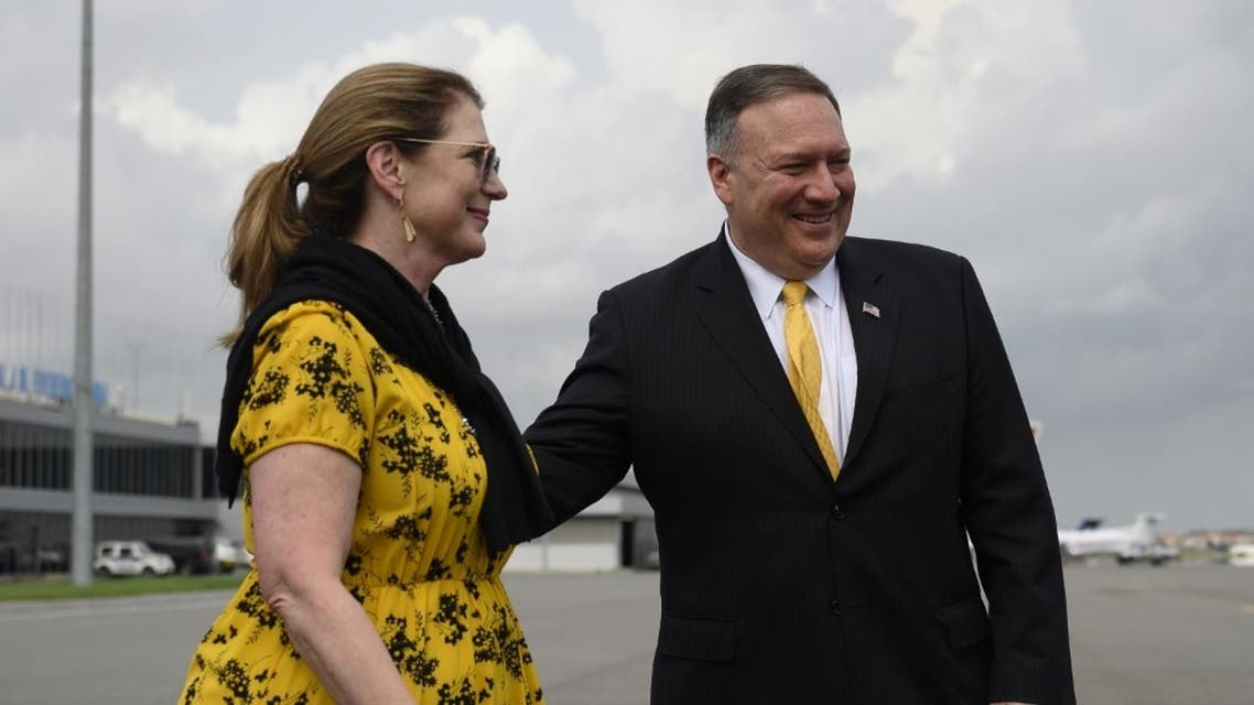 US Secretary of State, Mike Pompeo and his wife, Susan, on the tarmac before leaving Angola, Feb. 17, 2020. (AFP)