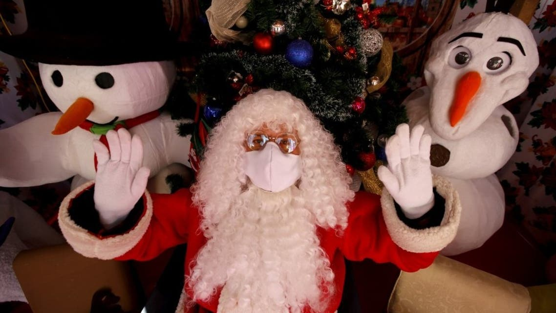 A Santa Claus gestures at a Christmas set, in Guadalajara in the state of Jalisco, Mexico, on December 20, 2020, amid the COVID-19 coronavirus pandemic. (AFP)