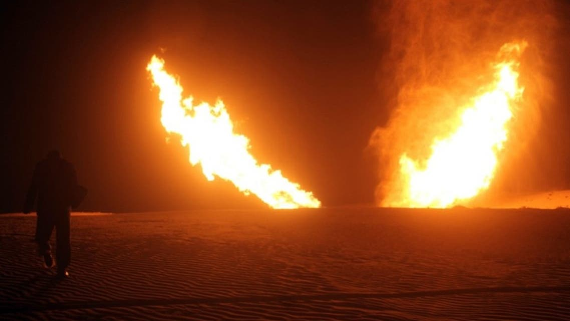 Flames raise from a pipeline that delivers gas to Israel and Jordan after it was hit by an explosion in the Al-Massaeed area, close to the town of Al-Arish in north Sinai, on MArch 5, 2012. (File photo: AFP)