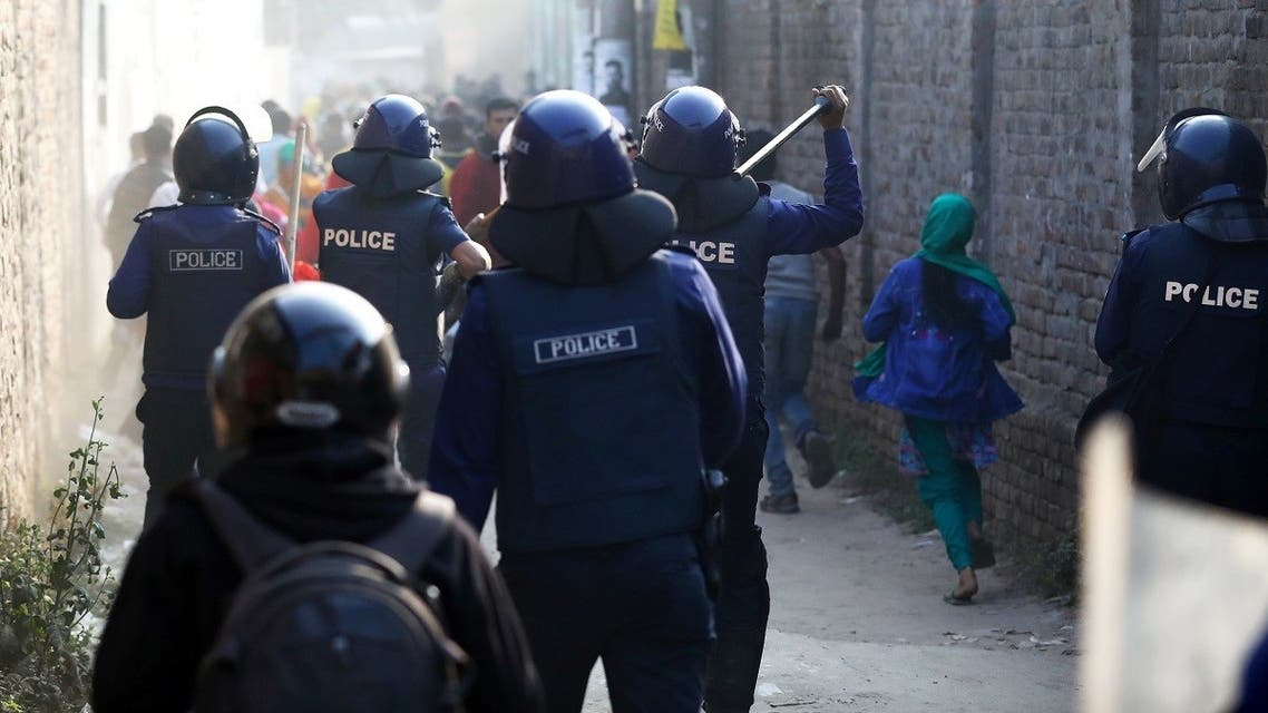 Police chase garments workers who have been protesting for higher wages at Ashulia, outskirt of Dhaka, Bangladesh, January 14, 2019. (Reuters/Mohammad Ponir Hossain)