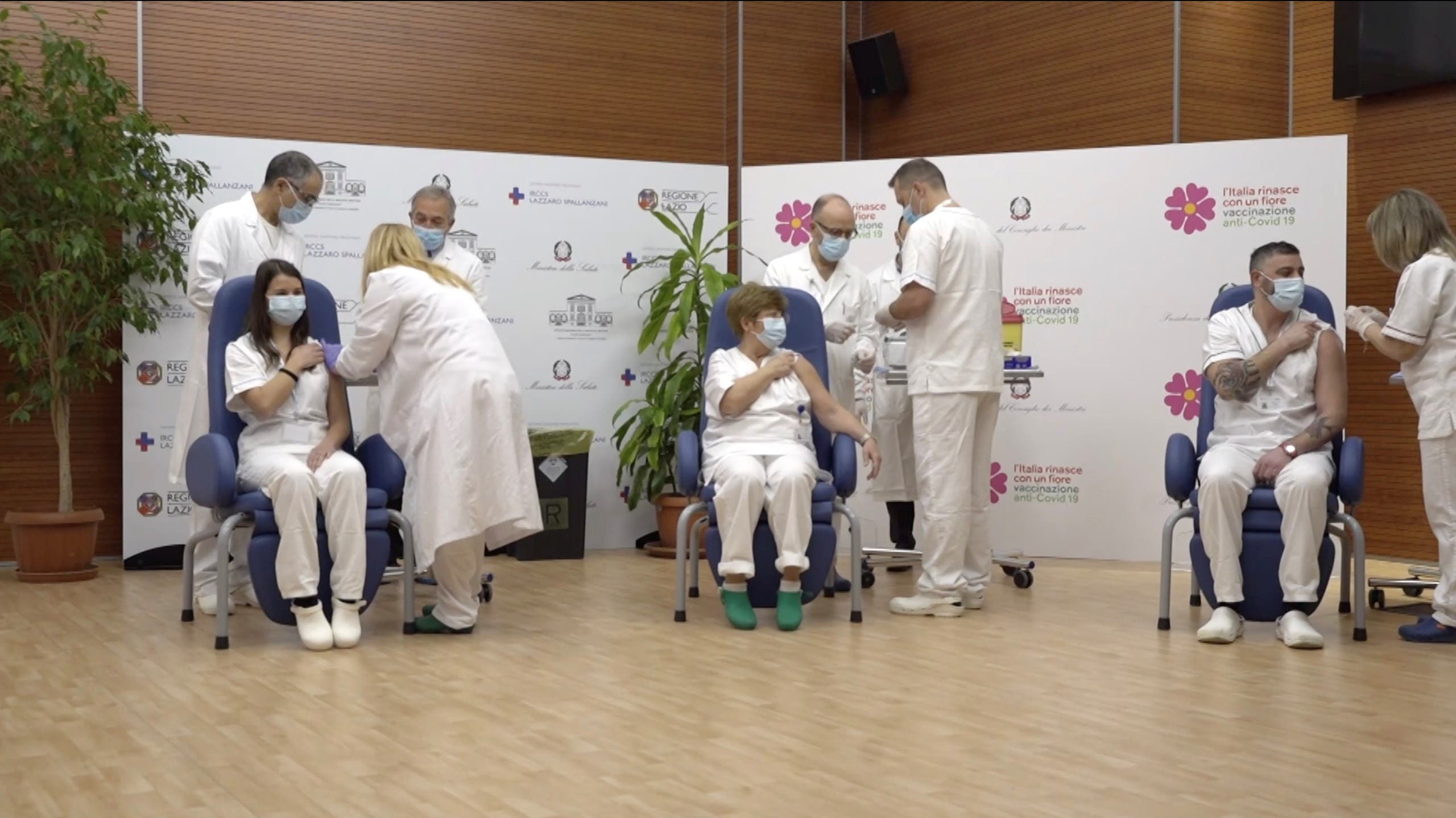 Claudia Alivernini, Maria Rosaria Capobianchi and Omar Altobelli, the first three recipients of Pfizer/BioNTech COVID-19 vaccine in Italy, receives their vaccination at the Spallanzani hospital in this screengrab taken from a video, in Rome, Italy December 27, 2020. (Ministero della Salute via Reuters)