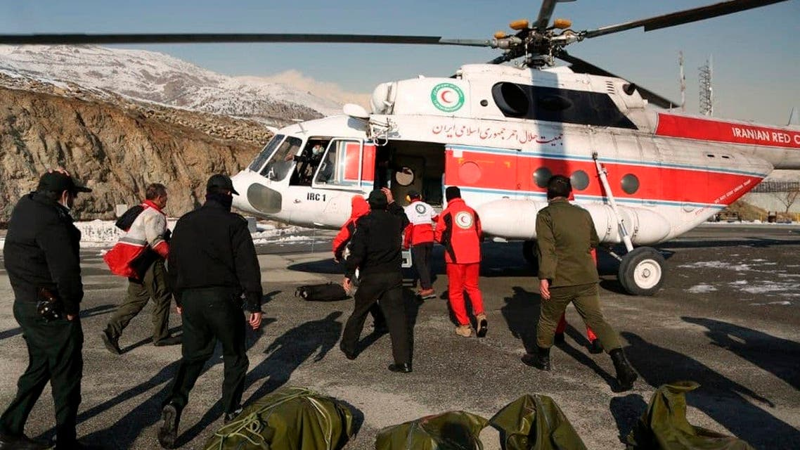 Rescuers work to unload bags containing bodies of mountaineers who died after avalanches in a mountainous area north of the capital Tehran, Iran. (AP)