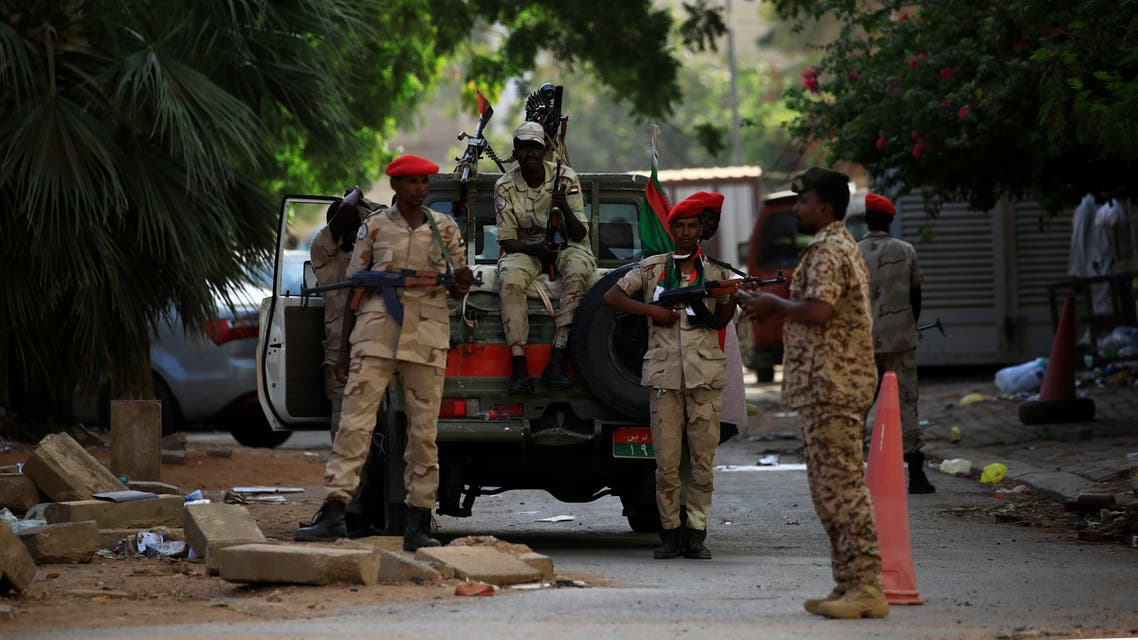 Sudanese soldiers secure the area as Sudan's ex-president Omar al-Bashir leaves the office of the anti-corruption prosecutor in Khartoum. (Reuters)