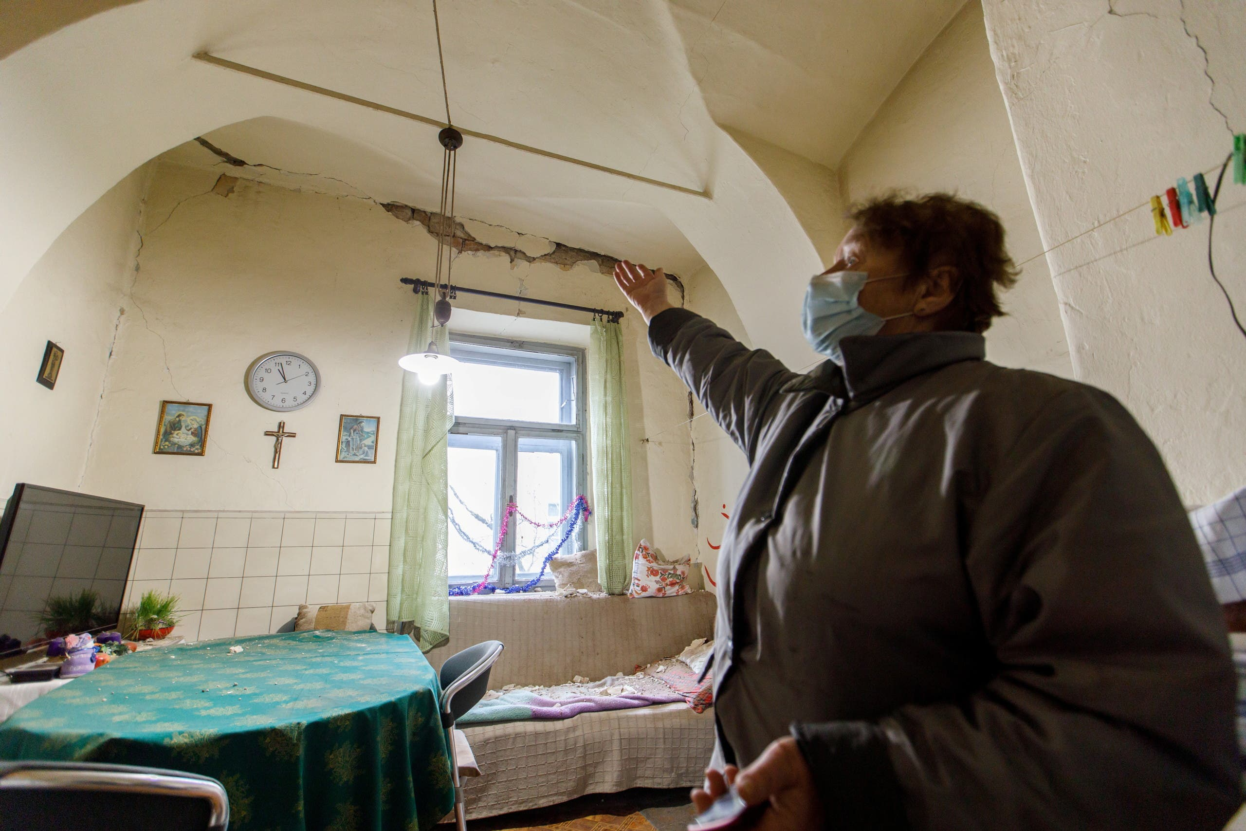 Ankica Loncarevic shows damages in her home after a 5.2 magnitude earthquake in Petrinja, Croatia, December 28, 2020. (Reuters)
