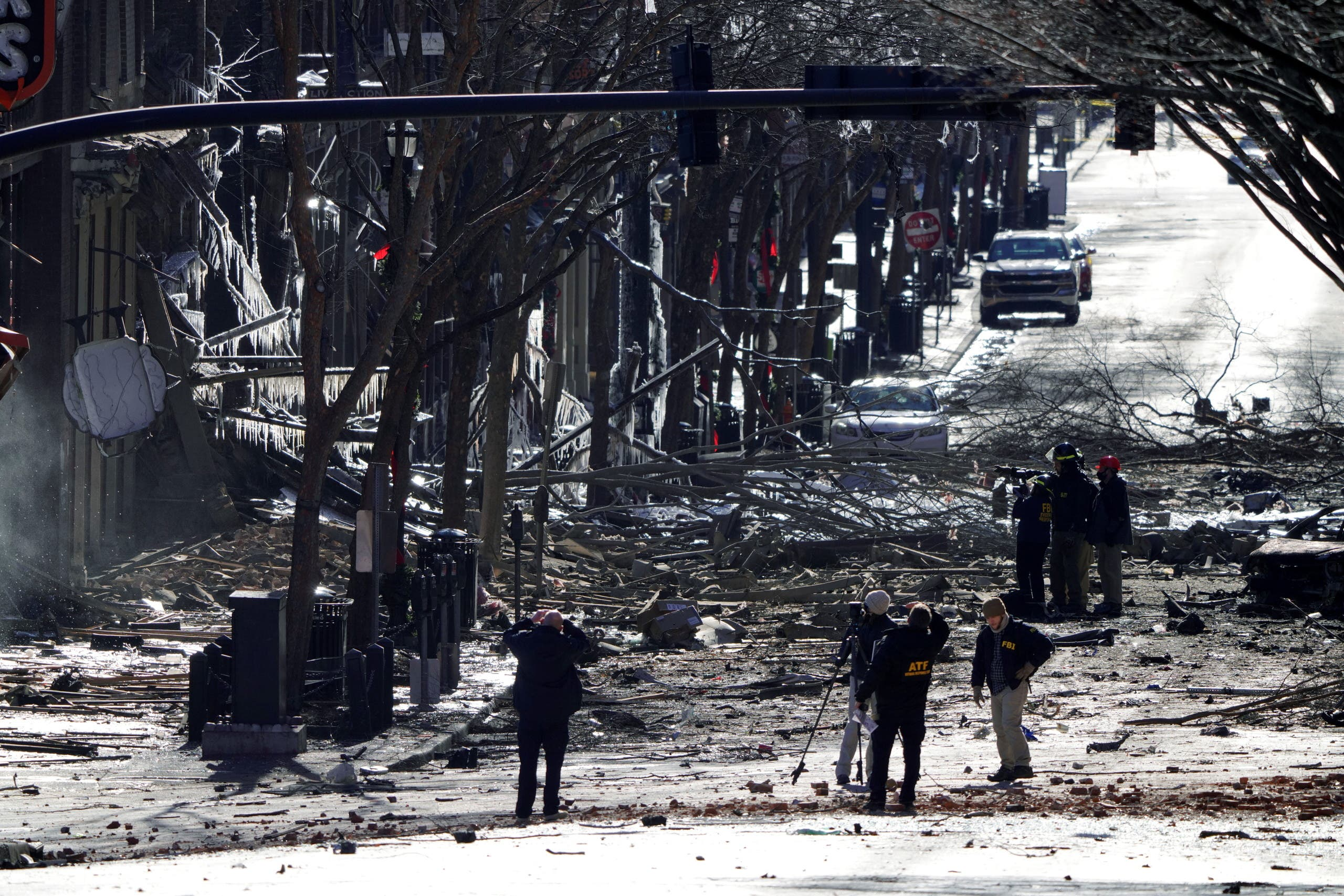 Investigators work near the site of an explosion on 2nd Avenue that occurred the day before in Nashville, Tennessee, US December 26, 2020. (Reuters)