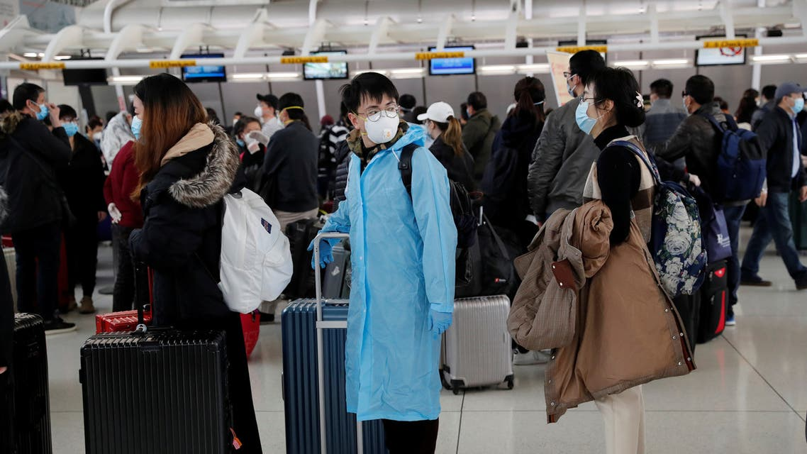 Passengers waiting to check in for an Air China flight are seen with face masks on, after further cases of coronavirus were confirmed in New York, at JFK International Airport in New York. (Reuters)