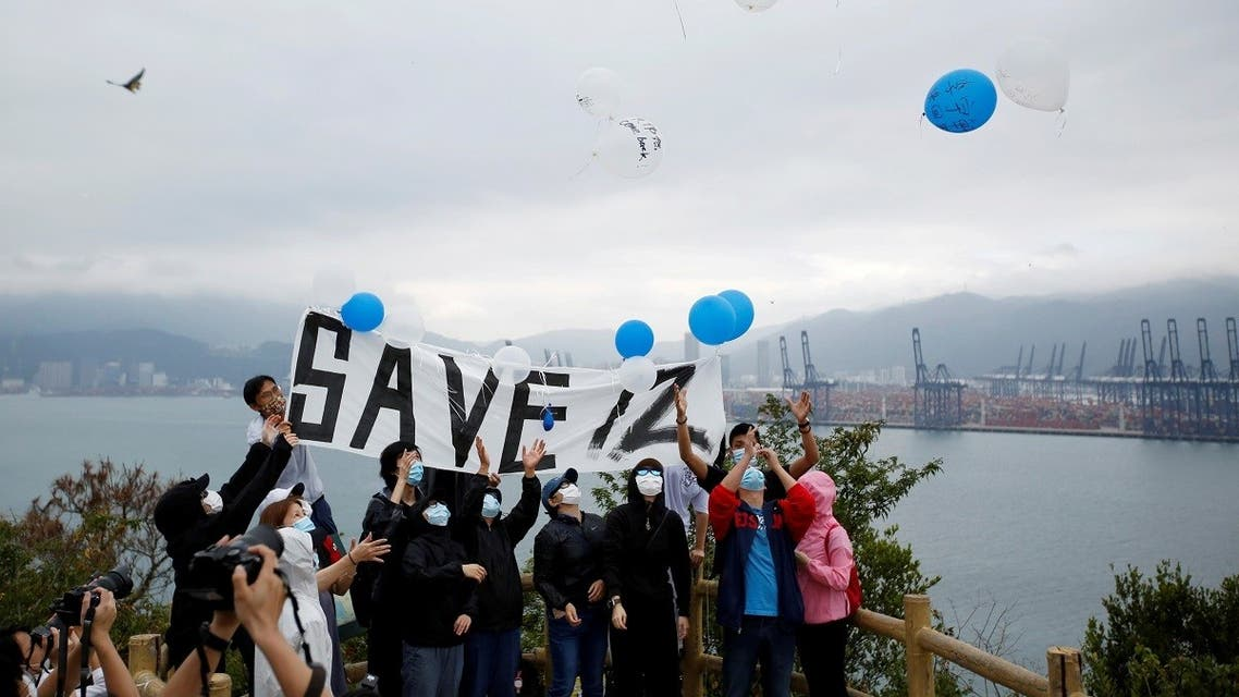 Relatives and supporters of the 12 Hong Kong people detained in mainland China release balloons from a peak overlooking Yantian district in the neighboring Chinese mainland city of Shenzhen, at a protest in Hong Kong, China. (File photo: Reuters)