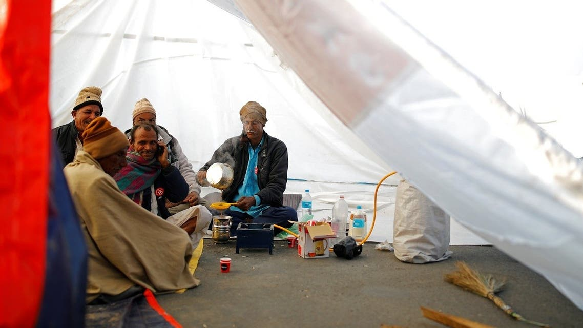 Farmers make tea inside a tent at the site of a protest against new farm laws, at a state border on a national highway in Shahjahanpur, in the desert state of Rajasthan, near New Delhi, India, on December 26, 2020. (Reuters)