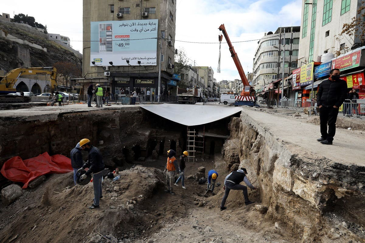 Archaeologists and workers excavate at a Roman archaeological site discovered during works to install a water drainage system, in downtown Amman, Jordan, on December 27, 2020. (Reuters)