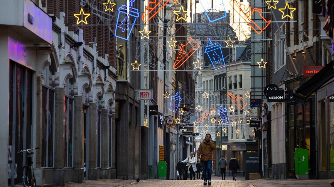 Man walking through Amsterdam's shopping district. (File photo: AP)