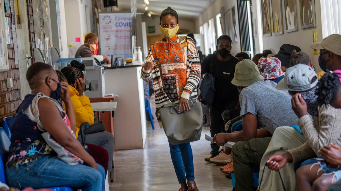 Volunteers wait to be checked at a vaccine trial facility set at Soweto's Chris Sani Baragwanath Hospital outside Johannesburg, South Africa, Monday Nov. 30, 2020. Over 2000 South African volunteers are on AstraZeneca's experimental coronavirus vaccine trial. (AP Photo/Jerome Delay)