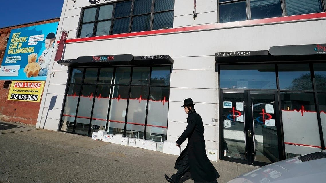 An Orthodox Jewish man walks past the exterior of Parcare's health care facility Sunday, Dec. 27, 2020, in the Willamsburg section of Brooklyn in New York. (AP/Kathy Willens)