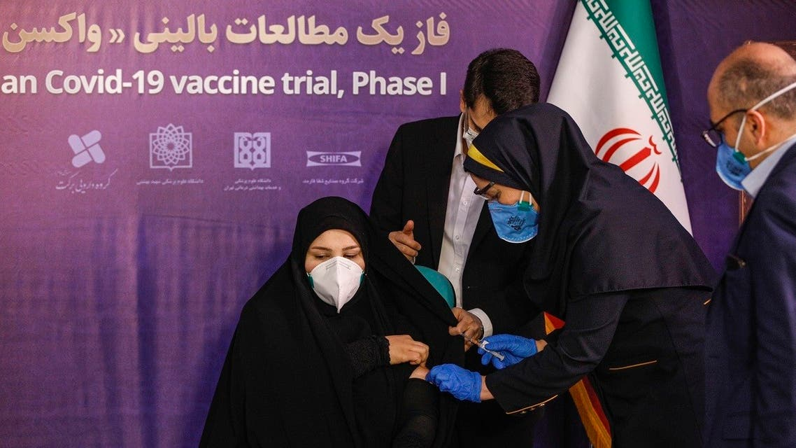 A woman receives an injection during the first trial phase of a locally-made Iranian vaccine for COVID-19 coronavirus disease in Iran's capital Tehran on December 29, 2020. (AFP)